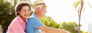 happy senior couple on a bike ride